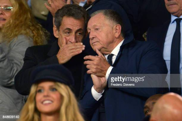 France former president Nicolas Sarkozy and the president of Olympique Lyonnais Football Club Jean Michel Aulas speak during the Ligue 1 match...