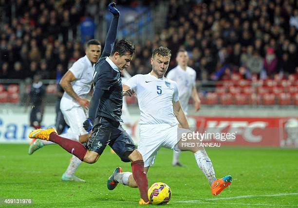 France forward Florian Thauvin fights for the ball with England defender Ben Gibson on November 17 2014 during an Under21 international friendly...