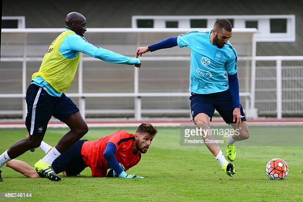 France forward Karim Benzema defender Eliaquim Mangala and the goalkeeper Benoit Costil during a training session at the French national football...