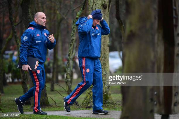 France forwards coach Yannick Bru and France defence coach Gerald Bastide arrive for the training session of the France rugby team at Centre National...