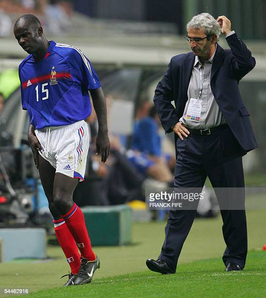 France defender Lilian Thuram leaves the field after being injured as France national team coach Raymond Domenech looks on during the 2006 World Cup...