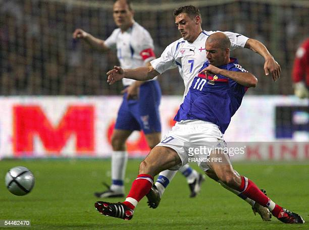 France midfielder and captain Zinedine Zidane vies with Faroe Islands midfielder Frodi Benjaminsen during the 2006 World Cup qualifying football...