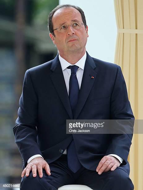 France Francois Hollandelooks on during Queen Elizabeth II's visit to the Paris Flower Market on June 7 2014 in Paris France Queen Elizabeth II and...