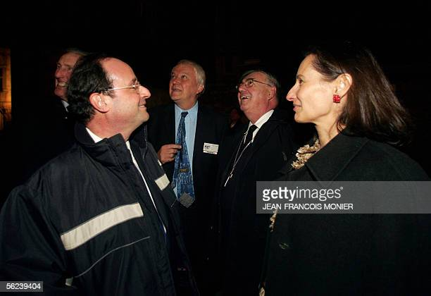 French Socialist party leader Francois Hollande and his wife Segolene Royale arrive at a diner with the International Socialist leaders at the...