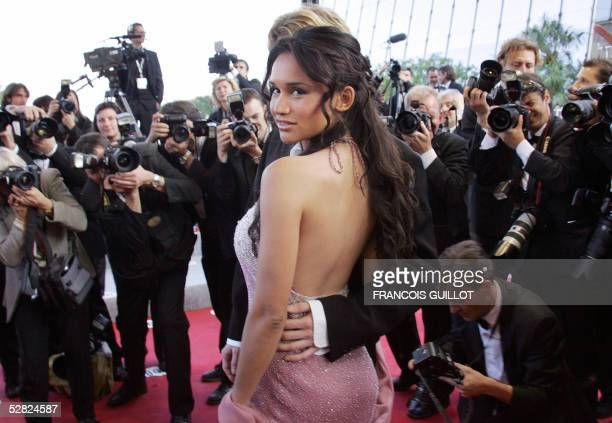 French starlet Talia and her companion pose for photographers as they arrive for the screening of Austrian director Michael Haneke's film 'Cache' 14...