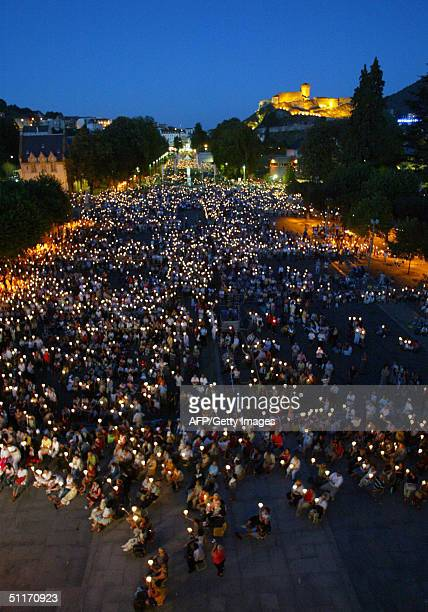 General view of a candle procession taken from Basilica in Lourdes 14 August 2004 John Paul II afflicted with Parkinson's disease is making his...