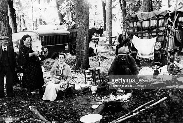 2WW france german occupation Refugees camping in the forest of Melun near Paris July 1940
