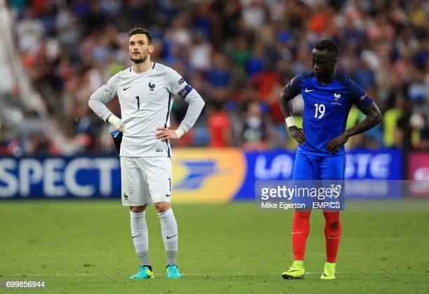 France goalkeeper Hugo Lloris and Bacary Sagna look dejected after the game