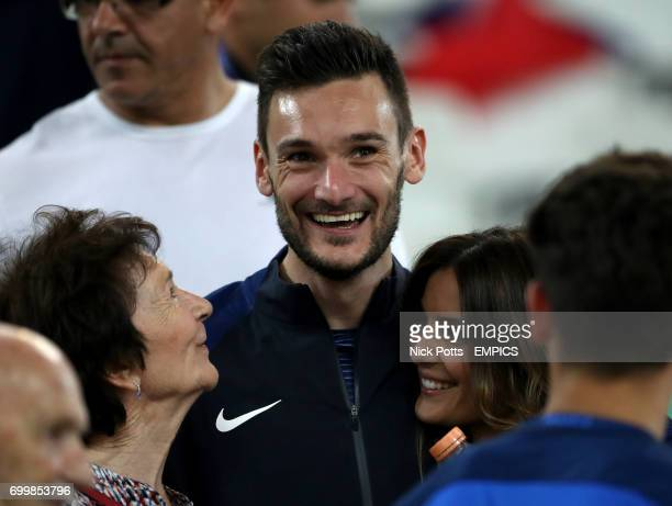France goalkeeper Hugo Lloris celebrates with wife Marine and mother Marie after the final whistle