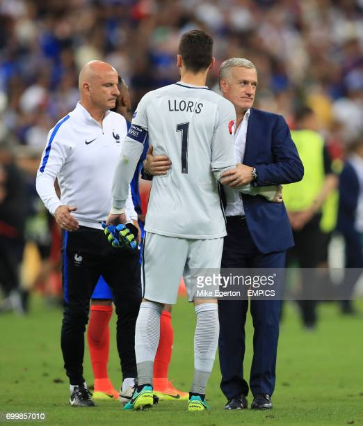 France goalkeeper Hugo Lloris is consoled by manager Didier Deschamps after the game