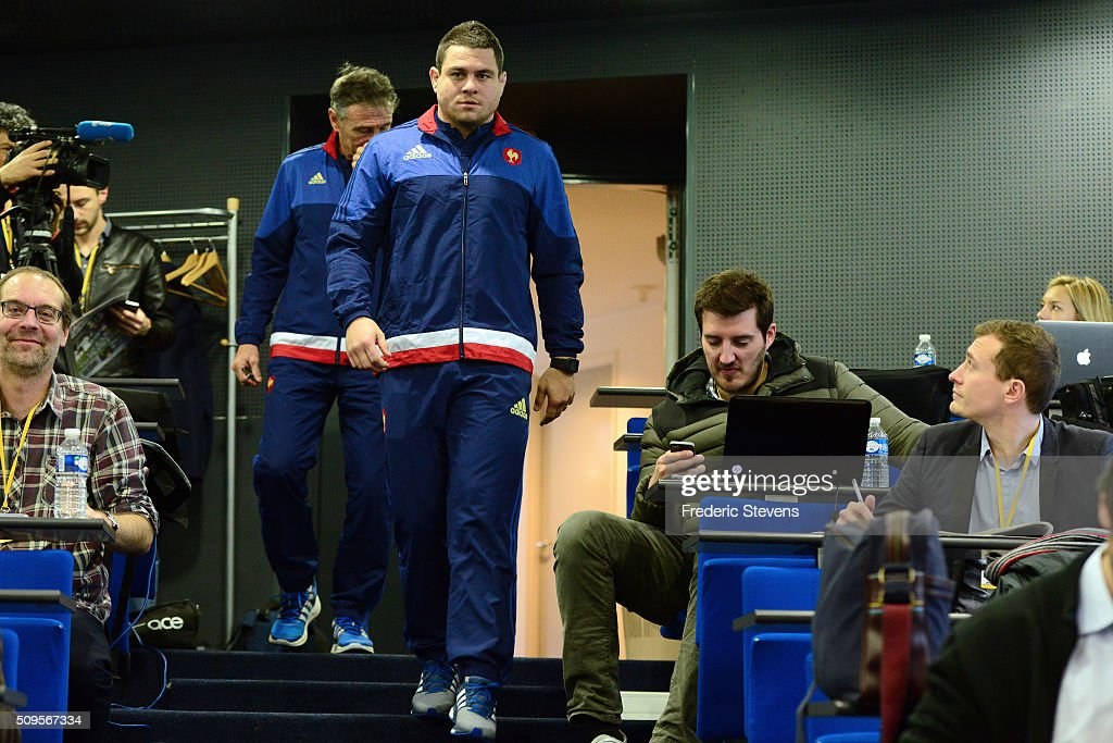 France head coach Guy Noves (B) and captain of France team Guilhem Guirado (F) arrive for a press conference at National Center of Rugby in Marcoussis, on February 18, 2016 in Paris, France. The press conference will announce the team members selected for France's Six Nations rugby match against Ireland in Paris on February 13.