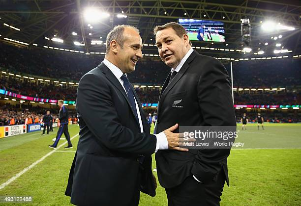 France head coach Philippe SaintAndre and New Zealand head coach Steve Hansen talk to each other after the 2015 Rugby World Cup Quarter Final match...