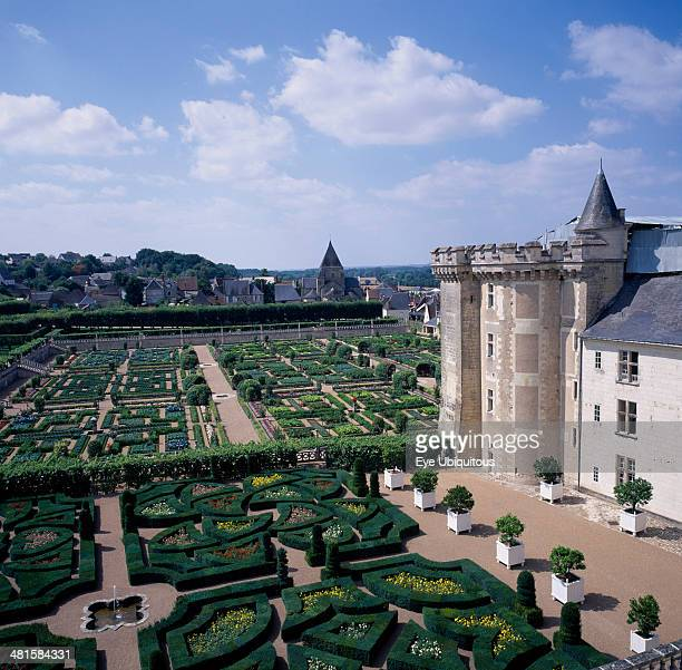 France Indre Loire Villandry View looking down across gardens and corner of chateau blue and cloudy sky