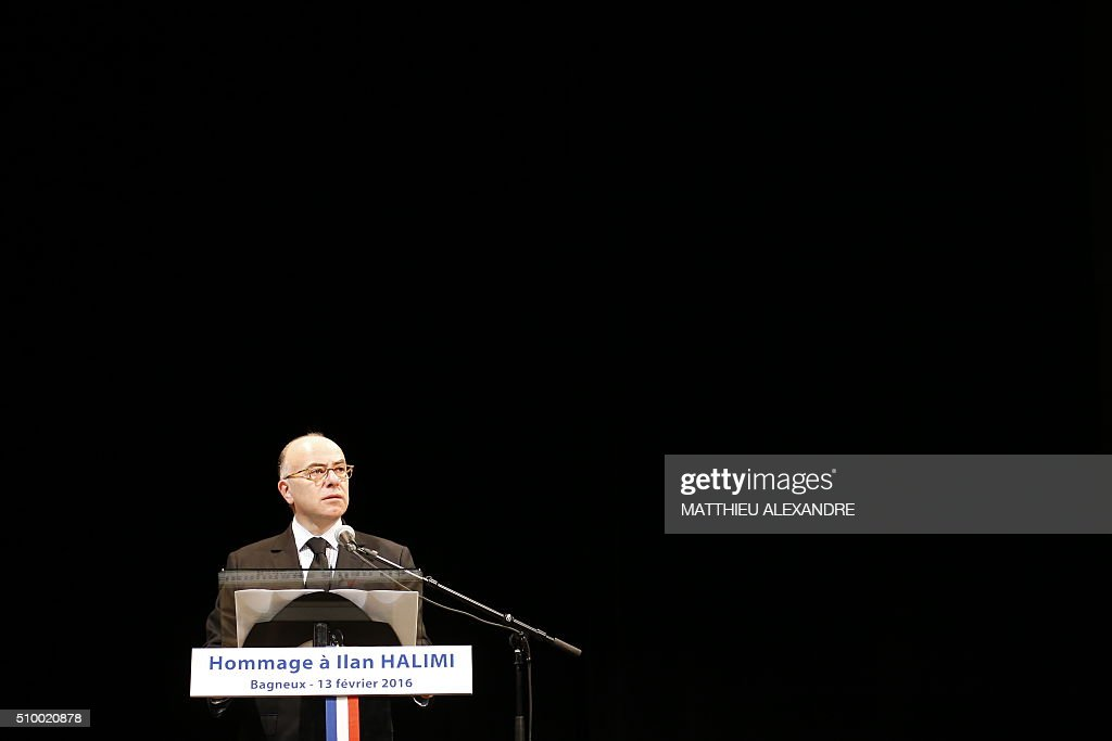 France Interior Minister Bernard Cazeneuve delivers a speech in tribute to Ilan Halimi, a 23-year-old Jewish Frenchman murdered on February 13, 2006 during a ceremony marking the 10th anniversary of his death, on February 13, 2016 in Bagneux, near Paris. Halimi, was murdered after he was kidnapped and tortured for three weeks by a gang in a Paris suburb. / AFP / MATTHIEU ALEXANDRE