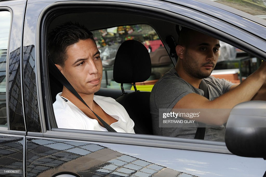 France international footballer Samir Nasri arrives in a car at the French Football Federation (FFF) headquarters, on July 27, 2012, to appear with France international footballers Yann Mvila, Hatem Ben Arfa and Jeremy Menez before a disciplinary commission of the FFF, to answer for their behaviour during the Euro 2012 tournament. Nasri will answer for a foul-mouthed tirade against journalists after France's Euro 2012 exit, Ben Arfa for a dispute with coach Laurent Blanc in the dressing room after their 2-0 loss to Sweden, Menez for rebukes against captain Hugo Lloris and insulting a referee, and Mvila for returning to the bench during their 2-0 loss against Spain without shaking his hands of Blanc and substitute Olivier Giroud. The four risk being suspended for bringing French football into disrepute just two years after the fiasco of France's 2010 World Cup campaign during which another four players Nicolas Anelka, Patrice Evra, Franck Ribery and Jeremy Toulalan received varying suspensions for their behaviour.