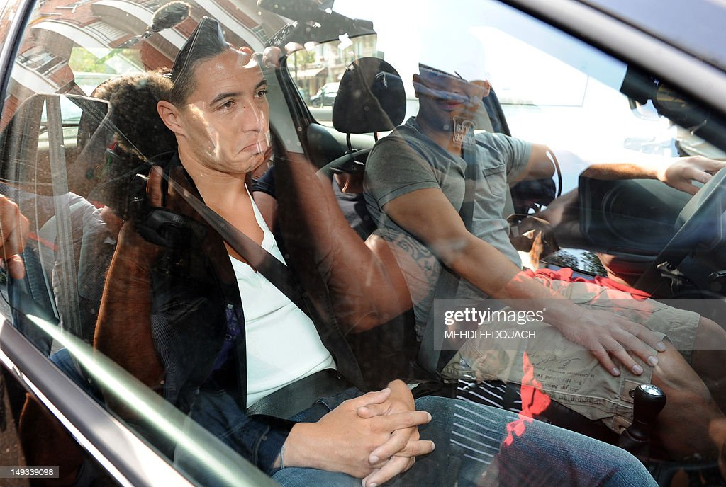 France international footballer Samir Nasri leaves in a car the French Football Federation (FFF) headquarters, on July 27, 2012, after he appeared with France international footballers Yann Mvila, Hatem Ben Arfa and Jeremy Menez before a disciplinary commission of the FFF, to answer for their behaviour during the Euro 2012 tournament. Nasri will answer for a foul-mouthed tirade against journalists after France's Euro 2012 exit, Ben Arfa for a dispute with coach Laurent Blanc in the dressing room after their 2-0 loss to Sweden, Menez for rebukes against captain Hugo Lloris and insulting a referee, and Mvila for returning to the bench during their 2-0 loss against Spain without shaking his hands of Blanc and substitute Olivier Giroud. The four risk being suspended for bringing French football into disrepute just two years after the fiasco of France's 2010 World Cup campaign during which another four players Nicolas Anelka, Patrice Evra, Franck Ribery and Jeremy Toulalan received varying suspensions for their behaviour. AFP PHOTO / MEHDI FEDOUACH