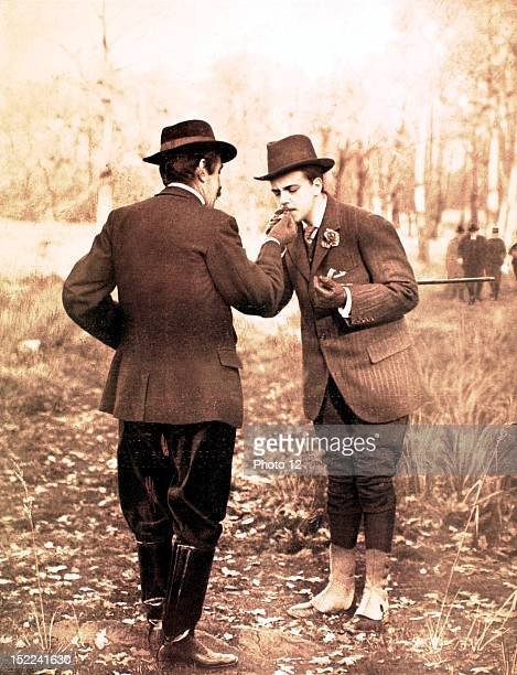 France King Manuel II of Portugal's stay in Paris At the Rambouillet hunt president of the council Mr Briand is giving the young sovereign a light