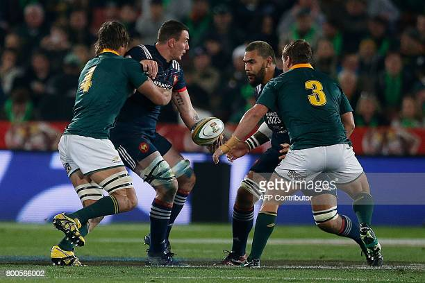 France lock Yoann Maestri gives the ball to France lock Romain Taofifenua during the third rugby union Test match between South Africa and France at...