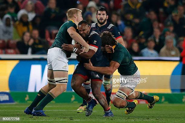 France loose head prop Jefferson Poirot is tackled during their third rugby union Test match between South Africa and France at the Emirates Ellis...