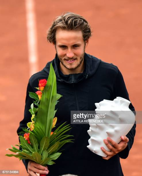 France' Lucas Pouille celebrates his victory over Great Britain's Aljaz Bedene after their final tennis match at the Hungarian Open in Budapest on...