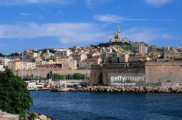 France Marseilles Entrance To Old Port Notre Dame De La Garde Church On Hill Top