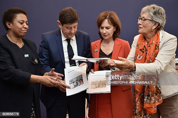 France Mediation President Chantal Uytterhaegen hands over a report 'Marches exploratoires quand les femmes changent la ville' to French Minister of...