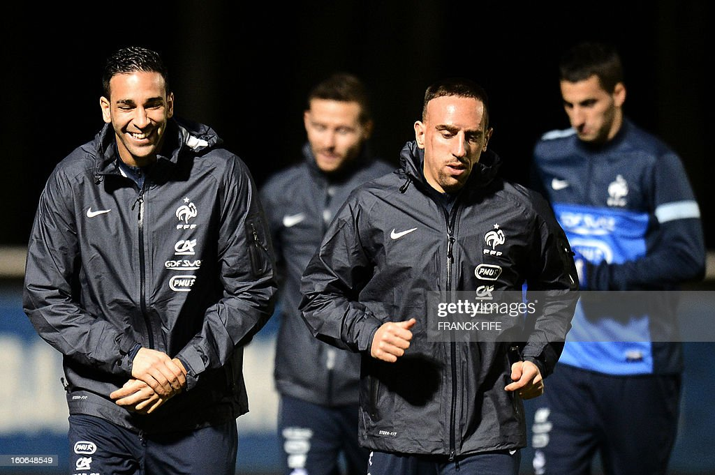 France national football team's defender Adil Rami (L) and forward Franck Ribery warm up during a training session, on February 4, 2013 in Clairefontaine-en-Yvelines, outside Paris, two days ahead of the friendly football match against Germany.