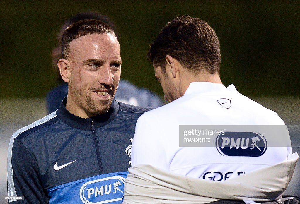 France national football team's forward Franck Ribery (L) is pictured during a training session, on February 4, 2013 in Clairefontaine-en-Yvelines, outside Paris, two days ahead of the friendly football match against Germany.
