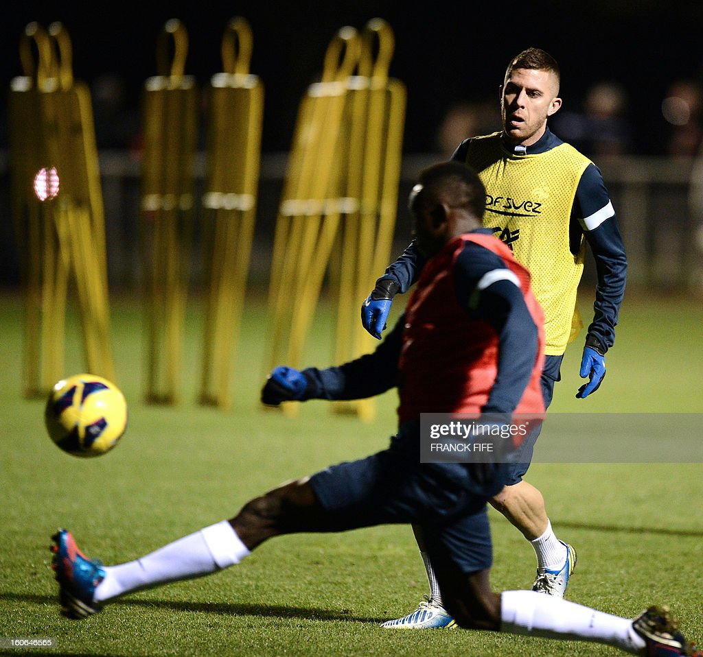 France national football team's forward Jeremy Menez (R) takes part in a training session, on February 4, 2013 in in Clairefontaine-en-Yvelines, outside Paris, two days ahead a friendly football match France vs Germany.