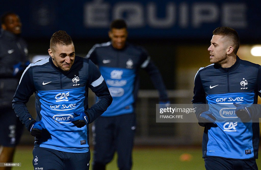 France national football team's forward Karim Benzema (L) jokes with forward Jeremy Menez during a training session, on February 4, 2013 in in Clairefontaine-en-Yvelines, outside Paris, two days ahead a friendly football match France vs Germany.