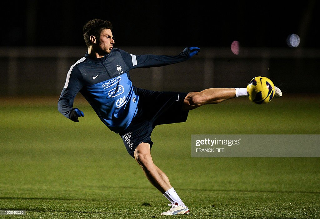France national football team's forward Olivier Giroud kicks the ball during a training session, on February 4, 2013 in in Clairefontaine-en-Yvelines, outside Paris, two days ahead a friendly football match France vs Germany.