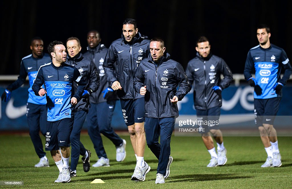 France national football team's mifielder Mathieu Valbuena, defender Adil Rami, forward Franck Ribery, midfielder Yohan Cabaye and midfielder Maxime Gonalons warm up during a training session, on February 4, 2013 in in Clairefontaine-en-Yvelines, outside Paris, two days ahead a friendly football match France vs Germany.