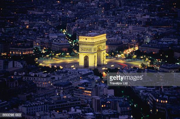 France, Paris, Arc de Triomphe, illuminated at night, aerial view