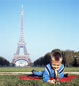 France, Paris, boy with model Eiffel Tower, Eiffel Tower in background
