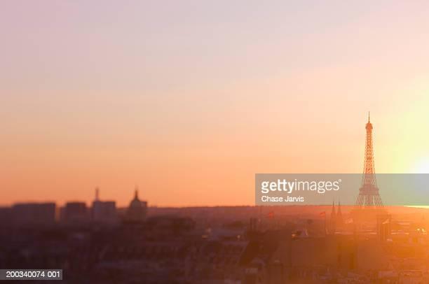 France, Paris, cityscape at sunset (soft focus)