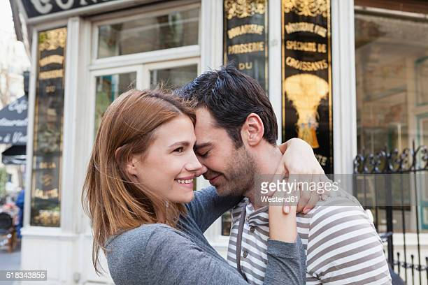 France, Paris, couple in love in front of pastry shop