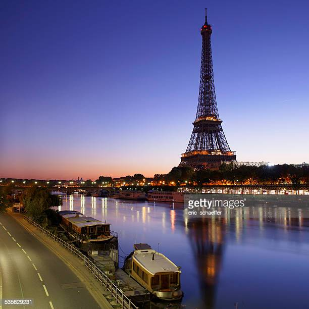 France, Paris, Eiffel Tower seen from across Seine River at sunrise