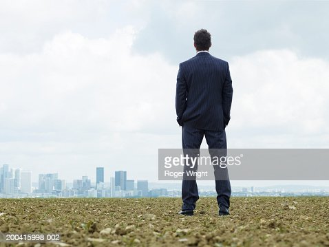 France, Paris, La Defense, businessman looking at cityscape, rear view : Foto stock