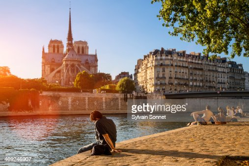 France, Paris, People relaxing by River Seine