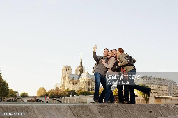 France, Paris, two couples taking self portrait by River Seine