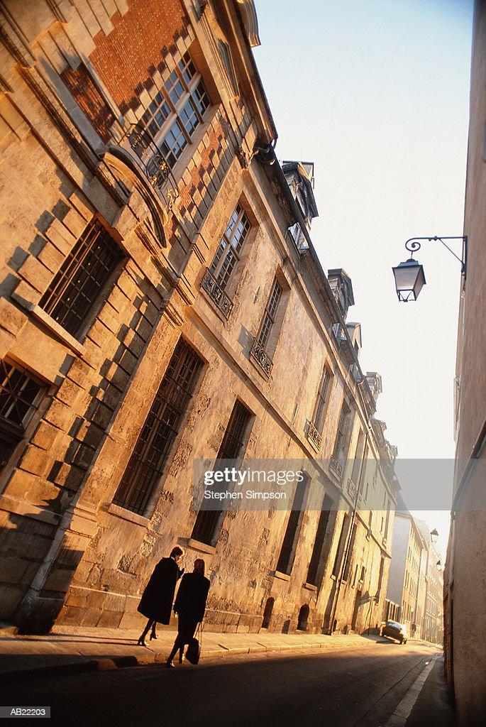 France, Paris, two women walking on street, rear view : Stock Photo