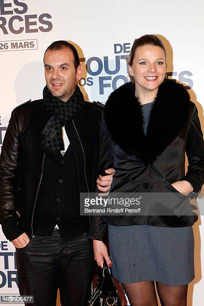 France Pierron and her boyfriend at Gaumont Capucines on March 17 2014 in Paris France