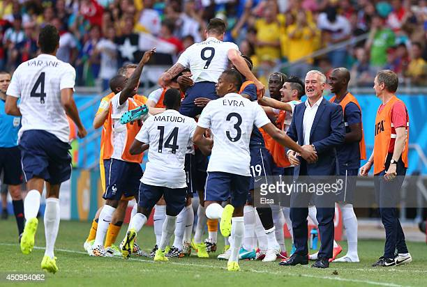 France players celebrate the first goal during the 2014 FIFA World Cup Brazil Group E match between Switzerland and France at Arena Fonte Nova on...