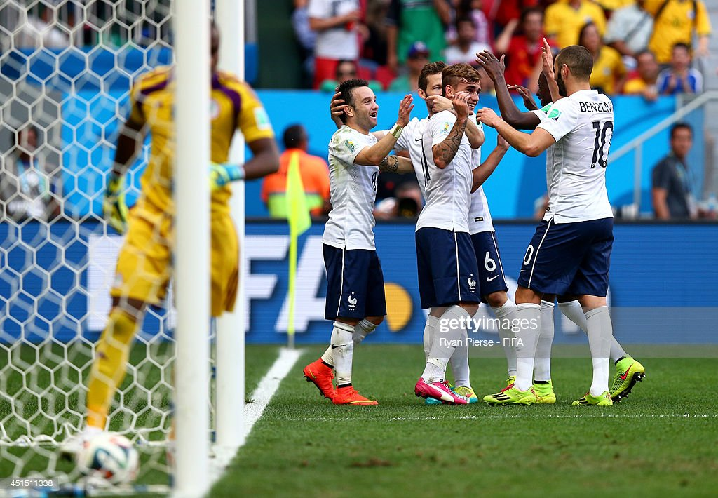France players celebrate their second goal during the 2014 FIFA World Cup Brazil Round of 16 match between France and Nigeria at Estadio Nacional on June 30, 2014 in Brasilia, Brazil.