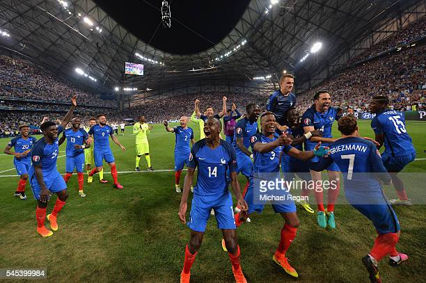 France players celebrate their team's 20 win in the UEFA EURO semi final match between Germany and France at Stade Velodrome on July 7 2016 in...
