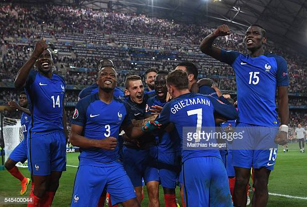 France players including Blaise Matuidi Patrice Evra and Paul Pogba celebrate victory with teammates after the UEFA EURO semi final match between...
