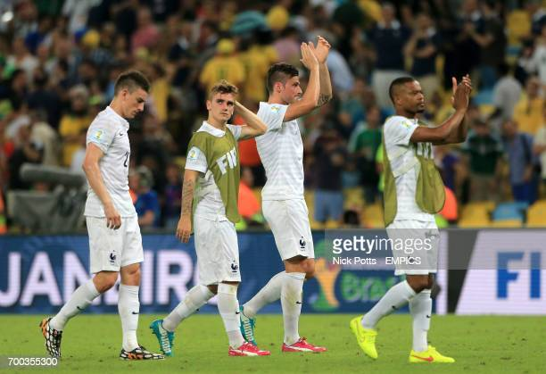 France players including Olivier Giroud Laurent Koscielny and Patrice Evra applaud the fans after the match