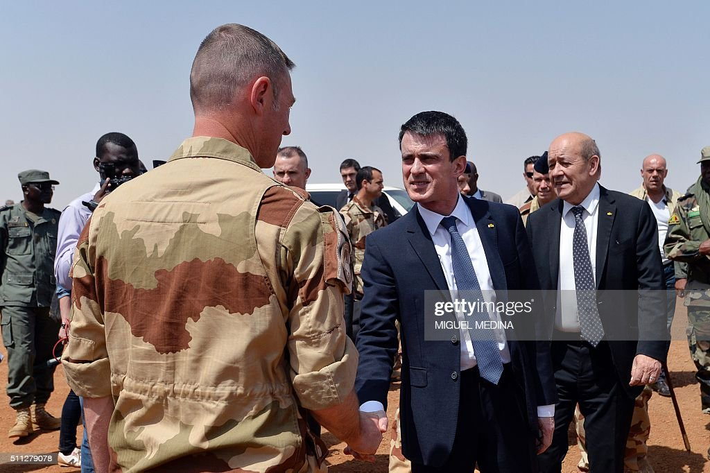 France Prime Minister Manuel Valls followed by France Defence Minister JeanYves Le Drian salutes soldiers during his visit to the troops of France's...