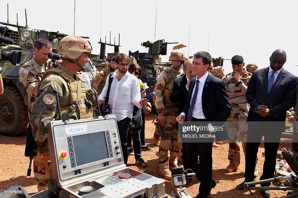 France Prime Minister Manuel Valls followed by France Defence Minister JeanYves Le Drian and Malian Defence Minister Tieman Hubert Coulibaly speaks...