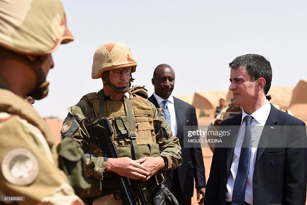 France Prime Minister Manuel Valls listens to French soldiers of Barkhane counterterrorism operation in Africa's Sahel region in a French military...